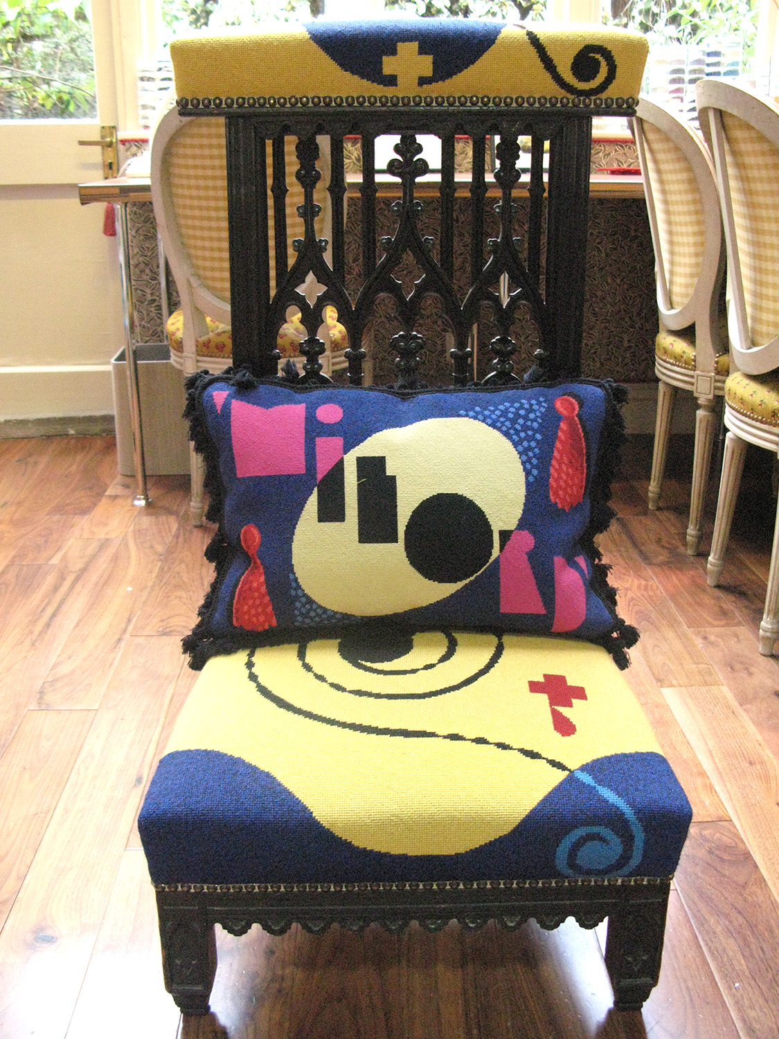 Milord cushion on cover, both designed by Caulfield